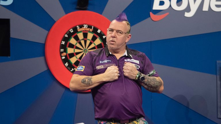 Peter Wright produced a spectacular run to break Dave Chisnall's Grand Slam hopes