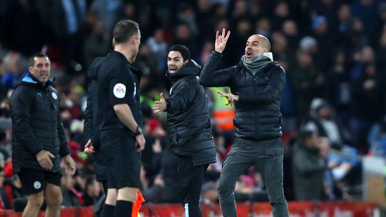 Guardiola gesticulates towards referee Oliver