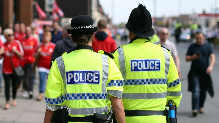 General view of police officers at football match