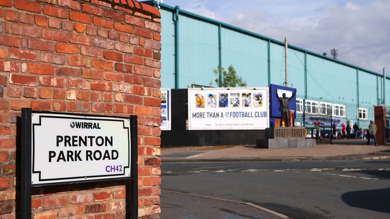 View from outside Prenton Park with the statue of John King in the background