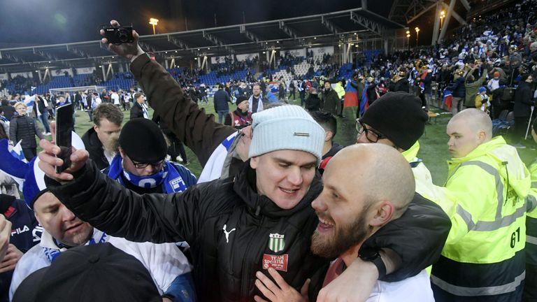 Teemu Pukki of Finland celebrates with fans