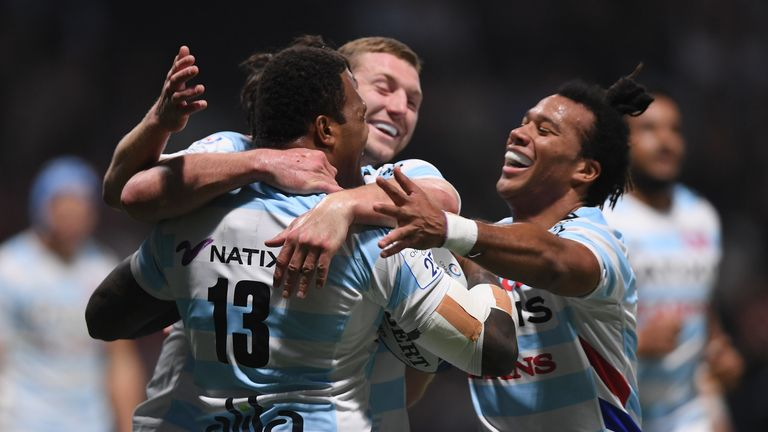Virimi Vakatawa of Racing 92 celebrates with team mates after crossing for the first try against Saracens