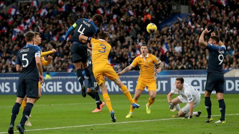 Raphael Varane rises to score for France against Moldova in Paris