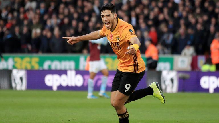 Raul Jimenez celebrates scoring Wolves' second goal against Aston Villa