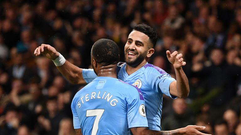 Riyad Mahrez celebrates with Raheem Sterling after putting Man City 2-1 up