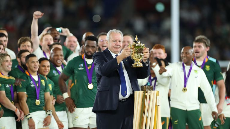 Bill Beaumont presents the William Webb Ellis trophy to South Africa after the 2019 final