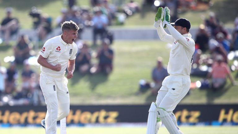 England seamer Sam Curran roars in celebration after dismissing New Zealand captain Kane Williamson