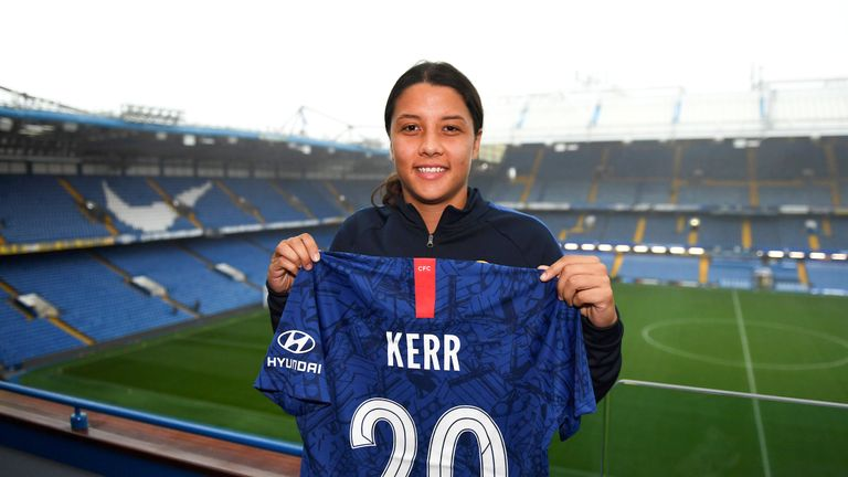 Sam Kerr poses for a photo at Stamford Bridge after signing for Chelsea