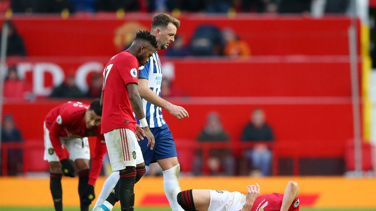 Scott McTominay goes down injured in Manchester United's 3-1 win over Brighton at Old Trafford