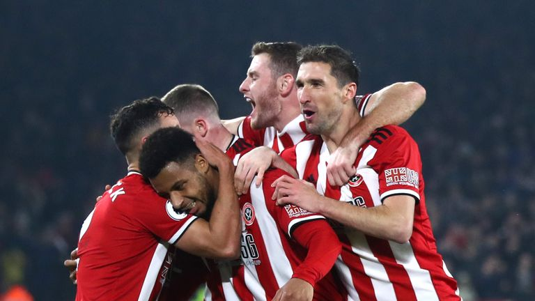 Mousset celebrates with his Blades team-mates after scoring against Manchester United