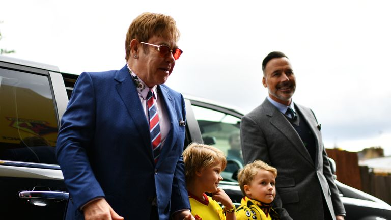 WATFORD, ENGLAND - SEPTEMBER 16: (L) Sir Elton John, Elijah Joseph Daniel Furnish-John, Zachary Jackson Levon Furnish-John and David Furnish (R) arrive at the stadium prior to the Premier League match between Watford and Manchester City at Vicarage Road on September 16, 2017 in Watford, England. (Photo by Dan Mullan/Getty Images)
