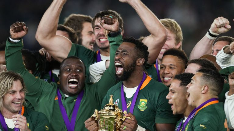 Siya Kolisi of South Africa celebrates with the Webb Ellis Cup after the Rugby World Cup 2019 Final between England and South Africa