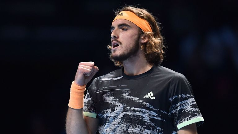 Stefanos Tsitsipas celebrates winning a point against Austria's Dominic Thiem during the men's singles final match on day eight of the ATP World Tour Finals tennis tournament at the O2 Arena in London on November 17, 2019.
