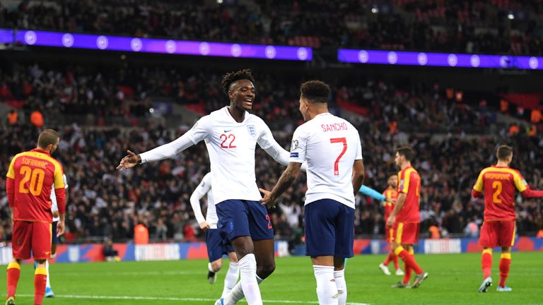 Tammy Abraham celebrates scoring England's seventh goal against Montenegro