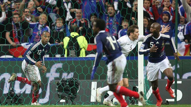 Henry and Gallas (right) celebrate France's controversial winner