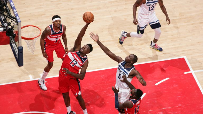 Thomas Bryant of the Washington Wizards rebounds the ball against the Minnesota Timberwolves