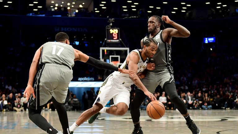 T.J. Warren of the Indiana Pacers drives against Taurean Prince and Garrett Temple of the Brooklyn Nets