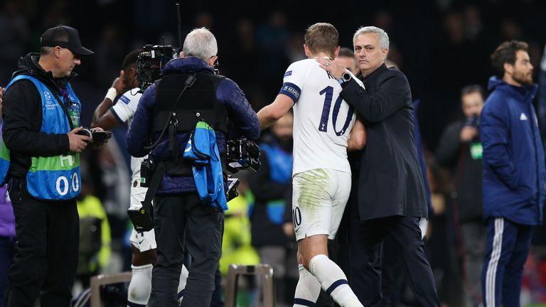Tottenham Hotspur manager Jose Mourinho embraces Harry Kane