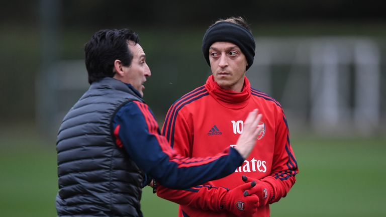 Unai Emery pictured with Mesut Ozil in training