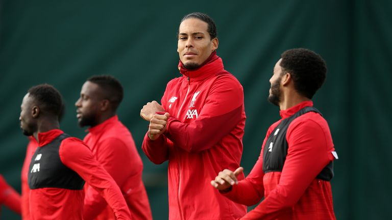 Virgil van Dijk chats with Joe Gomez during a Liverpool training session