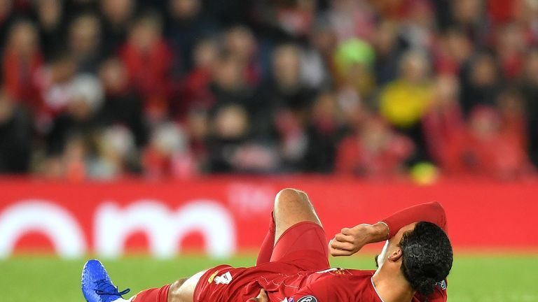 Virgil van Dijk of Liverpool reacts with an injury during the UEFA Champions League group E match between Liverpool FC and SSC Napoli at Anfield