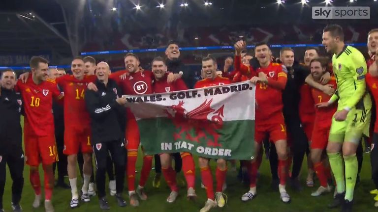 Gareth Bale celebrates Euro 2020 qualification with his team-mates by singing and parading a Wales flag which reads 'Wales. Golf. Madrid. In that order.'