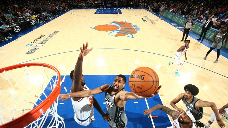 Spencer Dinwiddie rises to the rim against the New York Knicks