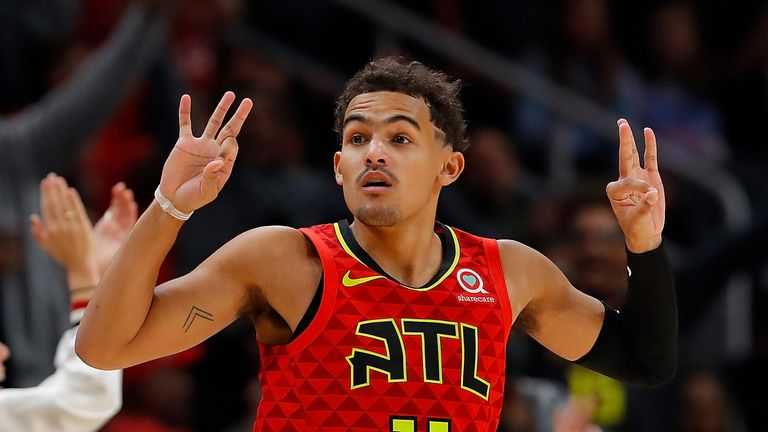 Trae Young celebrates after draining a three-pointer against San Antonio