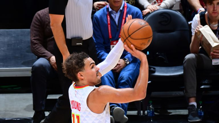 Trae Young shoots a three-pointer in the Hawks' loss to the Raptors