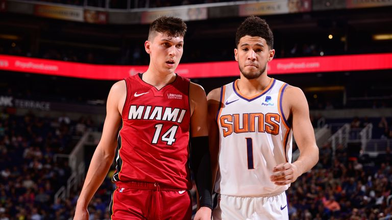 Tyler Herro and Devin Booker match up during the Heat's win over the Suns