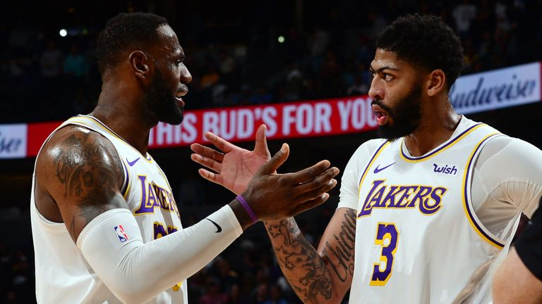 LeBron James and Anthony Davis celebrate the Lakers' win over the Nuggets
