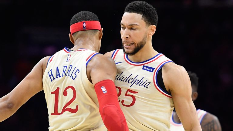 Ben Simmons chest-bumps Tobias Harris during the 76ers' win over the Bucks