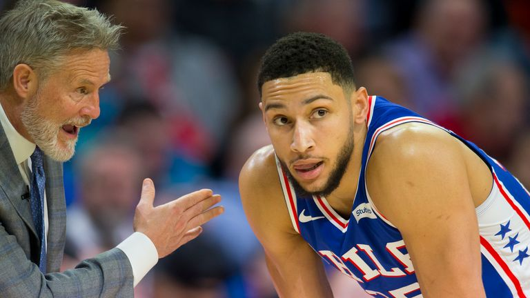 Brett Brown speaks to Ben Simmons during a game