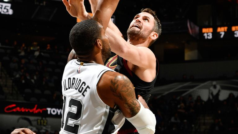 Kevin Love shoots over LaMarcus Aldridge