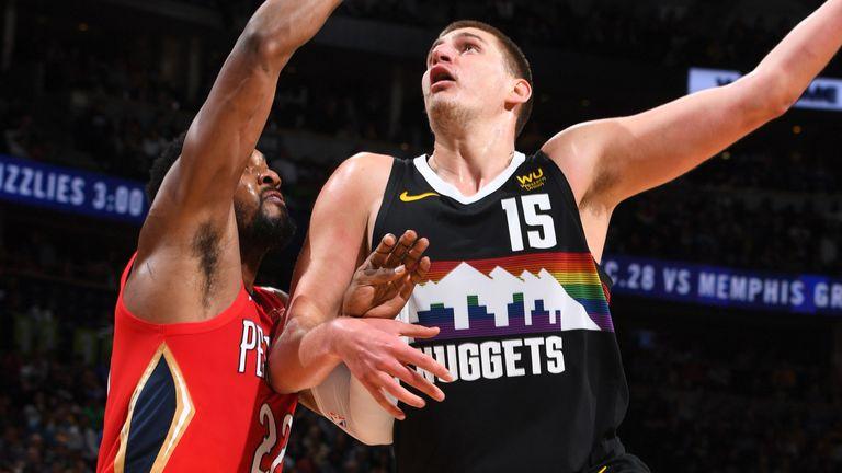 Nikola Jokic lofts a sky hook against the Pelicans