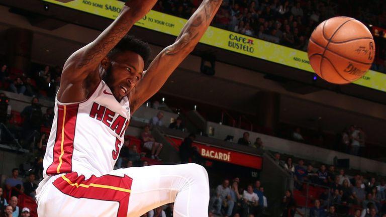 Derrick Jones Jr hammers home an alley-oop dunk against the Knicks