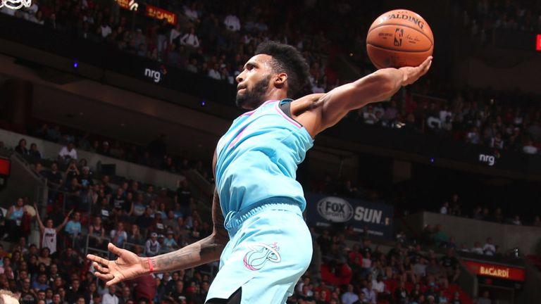 Derrick Jones Jr takes flight for a dunk against the Miami Heat