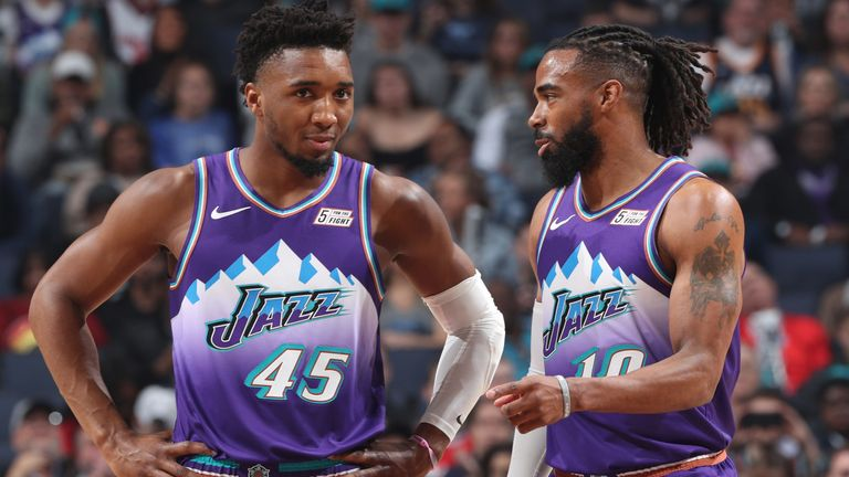 Mike Conley shares a word with backcourt partner Donovan Mitchell