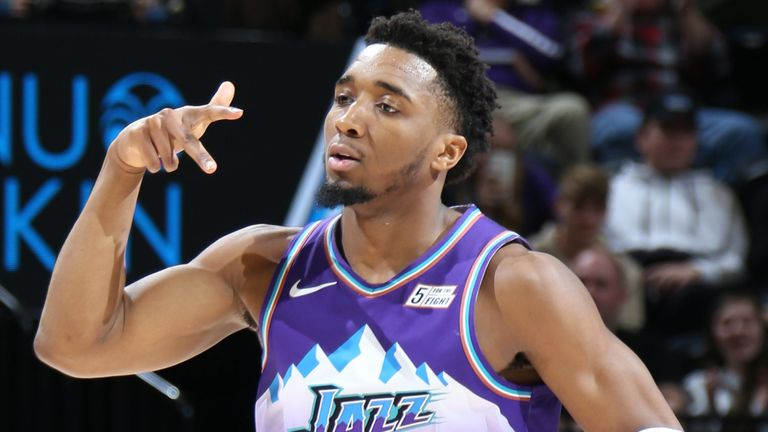 Donovan Mitchell celebrates after draining a three-pointer against the Portland Trail Blazers