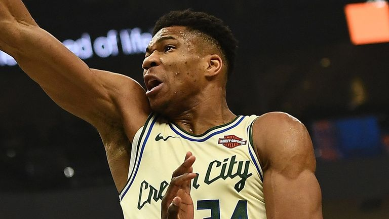 Giannis Antetokounmpo throws down a huge dunk against the New York Knicks