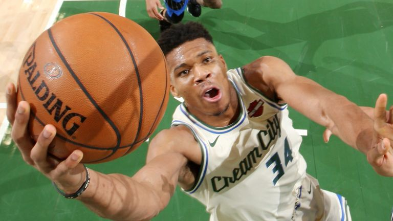 Giannis Antetokounmpo scores at the rim against Orlando