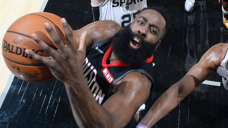James Harden attacks the basket against the San Antonio Spurs