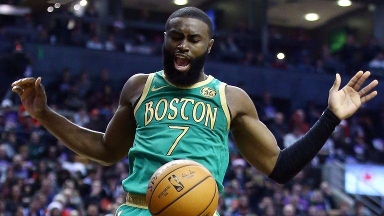 Jaylen Brown scores with a dunk against the Raptors