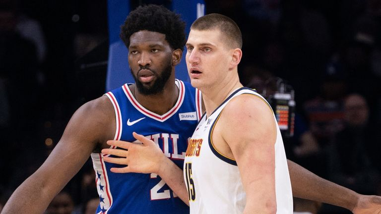 Joel Embiid defends Nikola Jokic in Philadelphia's win over the Denver Nuggets