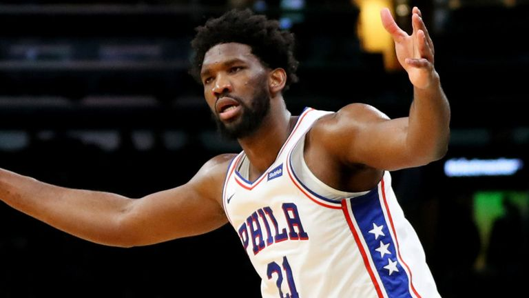 Joel Embiid questions a call during the Sixers' win over the Boston Celtics