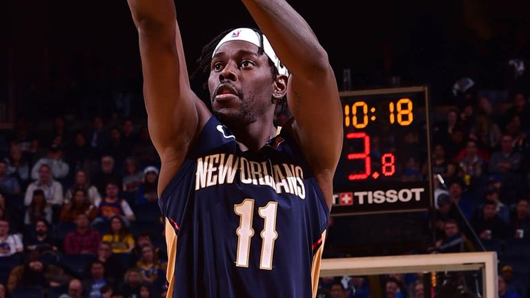 Jrue Holiday fires from long-range against Golden State