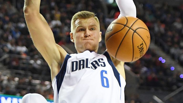 Kristaps Porzingis rams home a dunk against Detroit in Mexico City