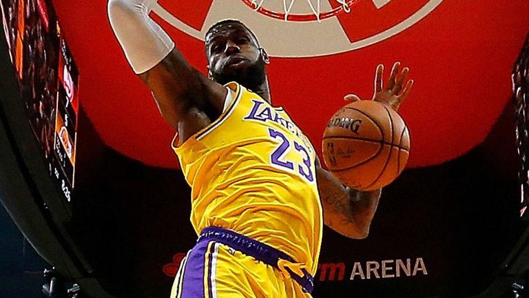 LeBron James powers home a dunk against the Atlanta Hawks