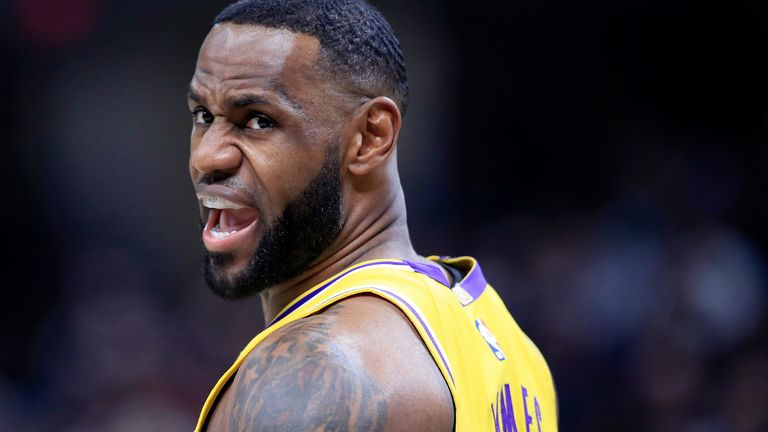 LeBron James encourages his team-mates during the Lakers' loss to the Pacers