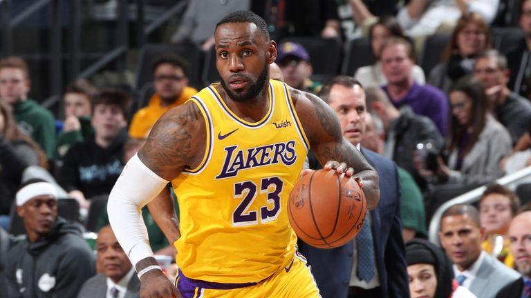 LeBron James dribbles upcourt against the Bucks